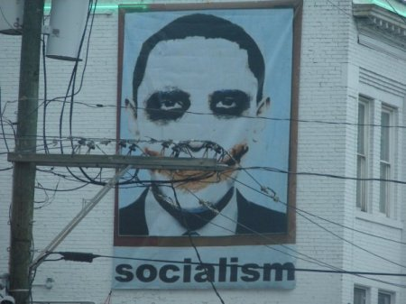 OBAMA FACE ON WALL WITH 'SOCIALISM' WRITTEN UNDERNEATH